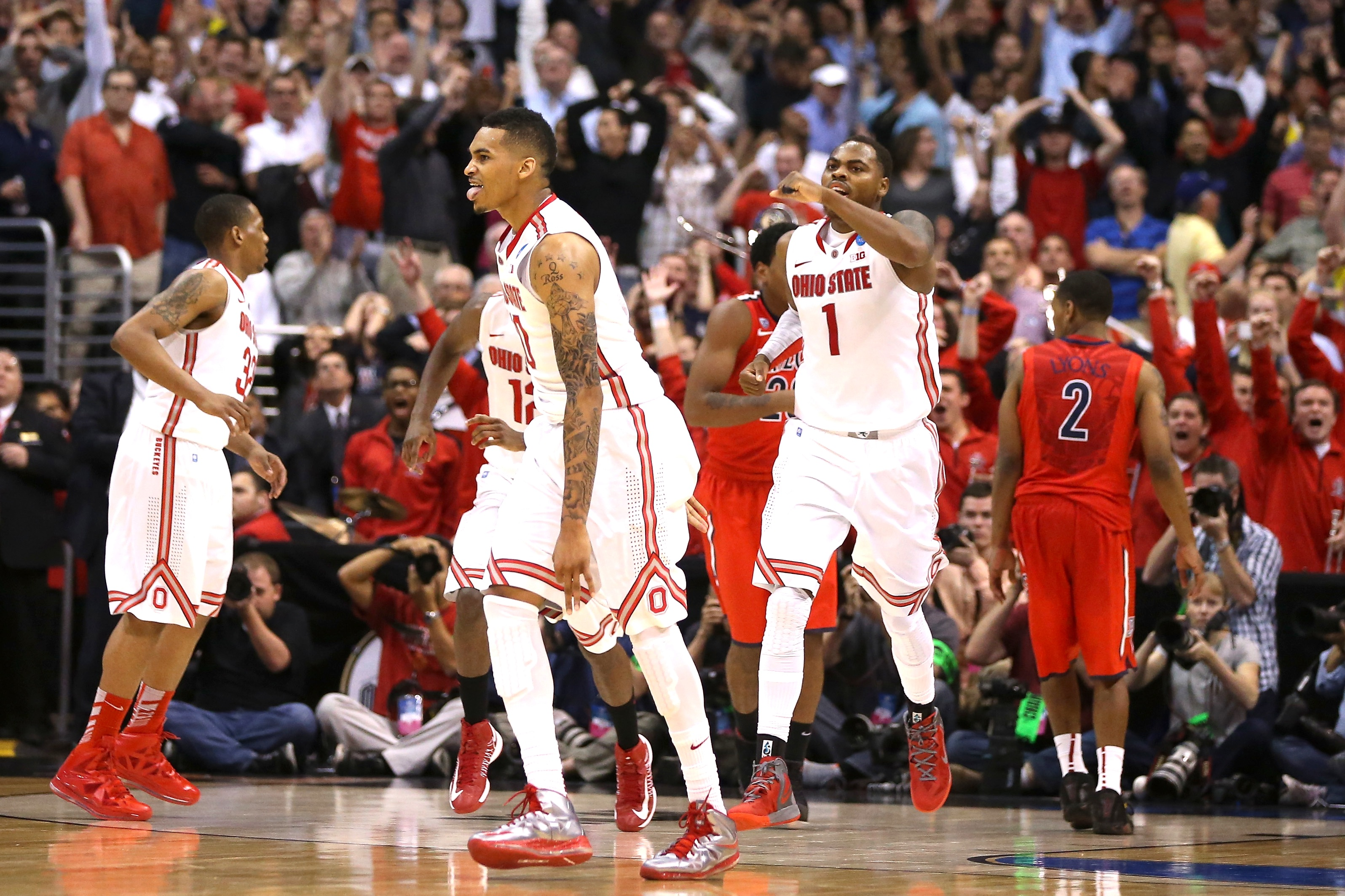 LOS ANGELES, CA - MARCH 28:  LaQuinton Ross #10 of the Ohio State Buckeyes reacts after he hits a three-pointer in the final seconds against the Arizona Wildcats during the West Regional of the 2013 NCAA Men's Basketball Tournament at Staples Center on March 28, 2013 in Los Angeles, California.  (Photo by Jeff Gross/Getty Images)