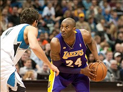 Mar 27, 2013; Minneapolis, MN, USA; Los Angeles Lakers shooting guard Kobe Bryant (24) looks to drive to the basket against Minnesota Timberwolves point guard Ricky Rubio (9) in the second quarter at Target Center. Lakers won 120-117. Mandatory Credit:  Greg Smith-USA TODAY Sports