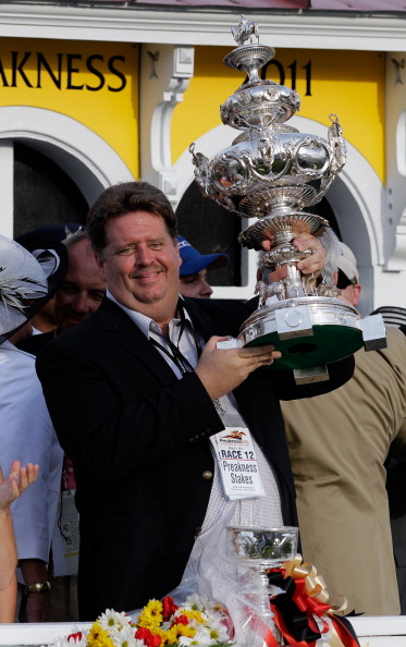 BALTIMORE, MD - MAY 21: Trainer Dale Romans celebrates in the winners circle after his horse Shackleford #5 won the 136th running of the Preakness Stakes at Pimlico Race Course on May 21, 2011 in Baltimore, Maryland.  (Photo by Rob Carr/Getty Images)