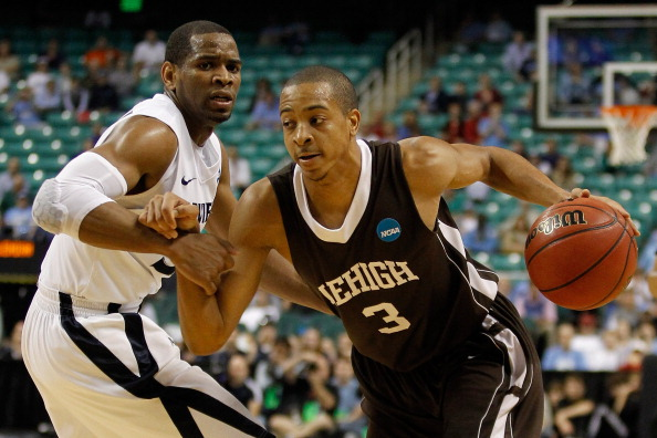 GREENSBORO, NC - MARCH 18:  C.J. McCollum #3 of the Lehigh Mountain Hawks drives on Tu Holloway #52 of the Xavier Musketeers in the second half during the third round of the 2012 NCAA Men's Basketball Tournament at Greensboro Coliseum on March 18, 2012 in Greensboro, North Carolina.  (Photo by Streeter Lecka/Getty Images)