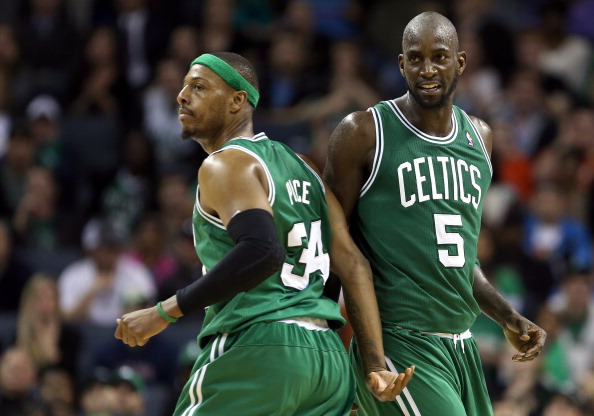 CHARLOTTE, NC - FEBRUARY 11:  Teammates Paul Pierce #34 and Kevin Garnett #5 of the Boston Celtics react after a basket against the Charlotte Bobcats during their game at Time Warner Cable Arena on February 11, 2013 in Charlotte, North Carolina. NOTE TO USER: User expressly acknowledges and agrees that, by downloading and or using this photograph, User is consenting to the terms and conditions of the Getty Images License Agreement.  (Photo by Streeter Lecka/Getty Images)