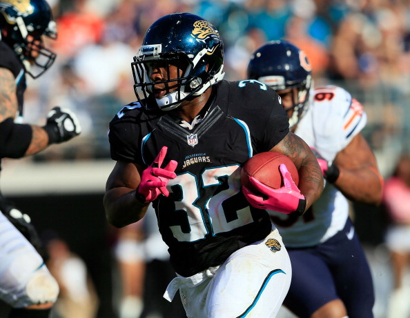 JACKSONVILLE, FL - OCTOBER 07:  Maurice Jones-Drew #32 of the Jacksonville Jaguars runs for yardge during the game against the Chicago Bears at EverBank Field on October 7, 2012 in Jacksonville, Florida.  (Photo by Sam Greenwood/Getty Images)