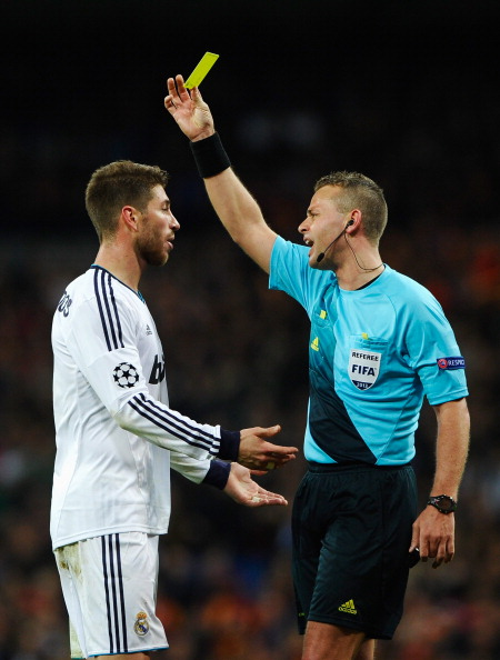 MADRID, SPAIN - APRIL 03: Referee Svein Oddvar Moen shows the yellow card to Sergio Ramos of Real Madrid during the UEFA Champions League Quarter Final first leg match between Real Madrid and Galatasaray at Estadio Santiago Bernabeu on April 3, 2013 in Madrid, Spain.  (Photo by Manuel Queimadelos Alonso/Getty Images)