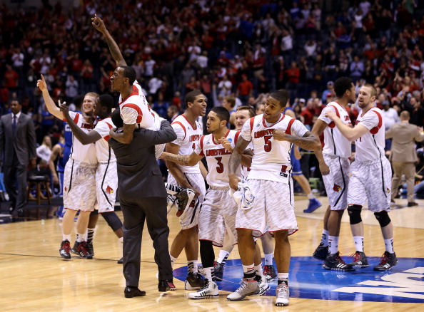INDIANAPOLIS, IN - MARCH 31:  (L-R) Russ Smith #2, Wayne Blackshear #20, Peyton Siva #3 and Chane Behanan #21 (wearing #5 jersey belonging to Kevin Ware, who fractured his leg in the first half) of the Louisville Cardinals celebrate with teammates after they won 85-63 against the Duke Blue Devils during the Midwest Regional Final round of the 2013 NCAA Men's Basketball Tournament at Lucas Oil Stadium on March 31, 2013 in Indianapolis, Indiana.  (Photo by Streeter Lecka/Getty Images)