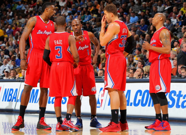 DENVER, CO - MARCH 07:  DeAndre Jordan #6, Chris Paul #3, Chauncey Billups #1, Blake Griffin #32 and Caron Butler #5 of the Los Angeles Clippers talk during a break in the action against the Denver Nuggets at the Pepsi Center on March 7, 2013 in Denver, Colorado. The Nuggets defeated the Clippers 107-92. NOTE TO USER: User expressly acknowledges and agrees that, by downloading and or using this photograph, User is consenting to the terms and conditions of the Getty Images License Agreement.  (Photo by Doug Pensinger/Getty Images)