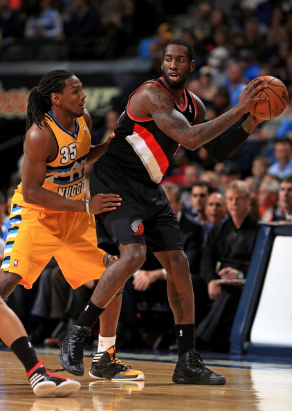 DENVER, CO - JANUARY 15:  J.J. Hickson #21 of the Portland Trail Blazers controls the ball against Kenneth Faried #35 of the Denver Nuggets at the Pepsi Center on January 15, 2013 in Denver, Colorado. The Nuggets defeated the Trail Blazers 115-111 in overtime. NOTE TO USER: User expressly acknowledges and agrees that, by downloading and or using this photograph, User is consenting to the terms and conditions of the Getty Images License Agreement.  (Photo by Doug Pensinger/Getty Images)