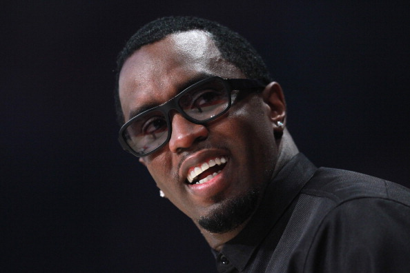 HOUSTON, TX - FEBRUARY 17:  Sean 'Diddy' Combs smiles during the 2013 NBA All-Star game at the Toyota Center on February 17, 2013 in Houston, Texas. NOTE TO USER: User expressly acknowledges and agrees that, by downloading and or using this photograph, User is consenting to the terms and conditions of the Getty Images License Agreement.  (Photo by Ronald Martinez/Getty Images)