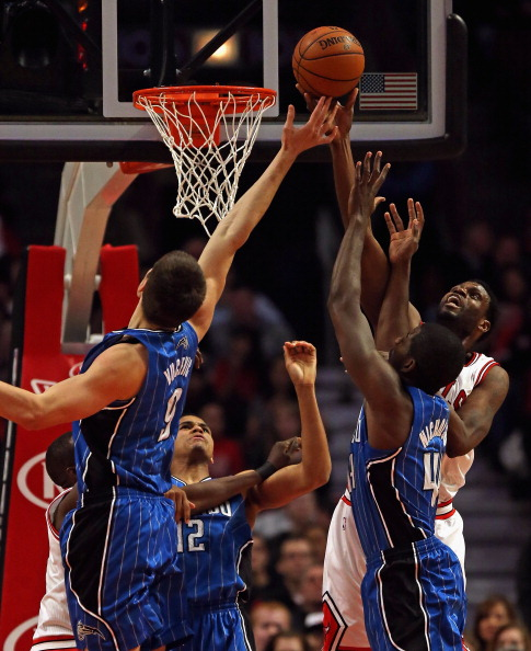 CHICAGO, IL - APRIL 05: Nazr Mohammed #48 of the Chicago Bulls shoots against (L-R) Nikola Vucevic #9, Tobias Harris #12 and Andrew Nicholson #44 of the Orlando Magic at the United Center on April 5, 2013 in Chicago, Illinois. NOTE TO USER: User expressly acknowledges and agrees that, by downloading and or using this photograph, User is consenting to the terms and conditions of the Getty Images License Agreement.  (Photo by Jonathan Daniel/Getty Images)