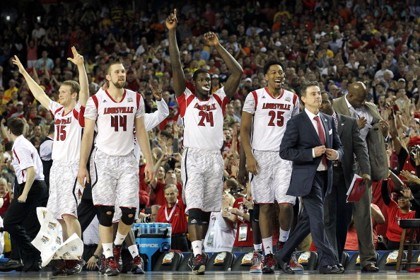 ATLANTA, GA - APRIL 06:  Head coach Rick Pitino of the Louisville Cardinals and the bench celebrate after the Cardinals defeat the Wichita State Shockers 72-68 during the 2013 NCAA Men's Final Four Semifinal at the Georgia Dome on April 6, 2013 in Atlanta, Georgia.  (Photo by Andy Lyons/Getty Images)