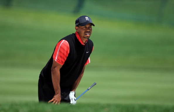 ORLANDO, FL - MARCH 25:  Tiger Woods of the United States plays his second shot at the par 5, 16th hole during the final round of the 2013 Arnold Palmer Invitational Presented by Mastercard at Bay Hill Golf and Country Club on March 25, 2013 in Orlando, Florida.  (Photo by David Cannon/Getty Images)