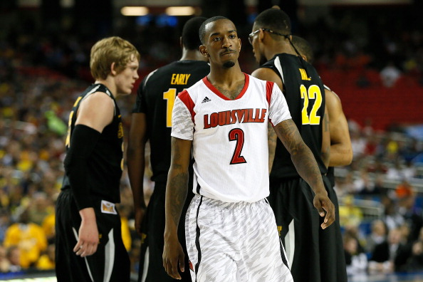 ATLANTA, GA - APRIL 06:  Russ Smith #2 of the Louisville Cardinals reacts in the first half as the Wichita State Shockers huddle during the 2013 NCAA Men's Final Four Semifinal at the Georgia Dome on April 6, 2013 in Atlanta, Georgia.  (Photo by Kevin C. Cox/Getty Images)
