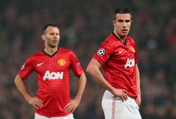 MANCHESTER, ENGLAND - MARCH 05:  Ryan Giggs (l) and Robin van Persie of Manchester United look dejected at the end of the UEFA Champions League Round of 16 Second leg match between Manchester United and Real Madrid at Old Trafford on March 5, 2013 in Manchester, United Kingdom.  (Photo by Alex Livesey/Getty Images)