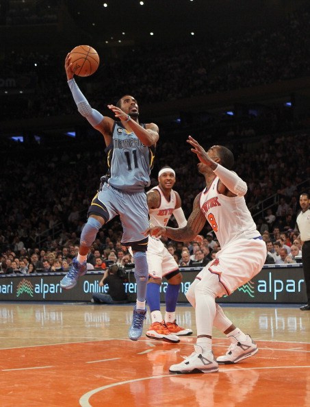 NEW YORK, NY - MARCH 27: Mike Conley #11 of the Memphis Grizzlies scores two in the second against the New York Knicks at Madison Square Garden on March 27, 2013 in New York City. NOTE TO USER: User expressly acknowledges and agrees that, by downloading and/or using this photograph, user is consenting to the terms and conditions of the Getty Images License Agreement.  (Photo by Bruce Bennett/Getty Images)