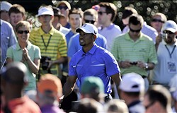 Apr 10, 2013; Augusta, GA, USA; Tiger Woods walks off the 15th tee box during a practice round for the 2013 The Masters golf tournament at Augusta National Golf Club.  Mandatory Credit: Jack Gruber-USA TODAY Sports