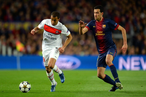 BARCELONA, SPAIN - APRIL 10:  Lucas of PSG is challenged by Sergio Busquets of Barcelona during the UEFA Champions League quarter-final second leg match between Barcelona and Paris St Germain at Nou Camp on April 10, 2013 in Barcelona, Spain.  (Photo by Shaun Botterill/Getty Images)