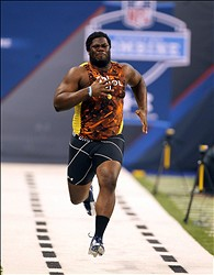 Feb 23, 2013; Indianapolis, IN, USA; North Carolina offensive lineman Jonathan Cooper runs the 40 yard dash during the 2013 NFL Combine at Lucas Oil Stadium.  Mandatory Credit: Brian Spurlock-USA TODAY Sports