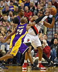 Apr 10, 2013; Portland, OR, USA; Los Angeles Lakers shooting guard Kobe Bryant (24) defends against Portland Trail Blazers power forward LaMarcus Aldridge (12) at the Rose Garden. Mandatory Credit: Craig Mitchelldyer-USA TODAY Sports