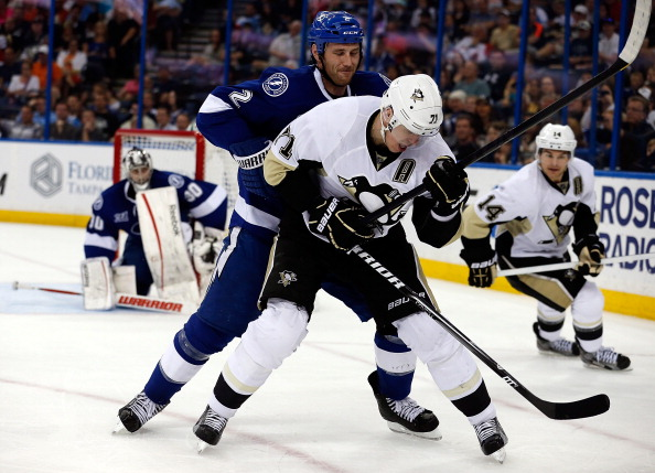 TAMPA - APRIL 11: Defenseman Eric Brewer #2 of the Tampa Bay Lightning battles Evgeni Malkin #71 of the Pittsburgh Penguins for position during the game at the Tampa Bay Times Forum on April 11, 2013 in Tampa, Florida. (Photo by J. Meric/Getty Images)