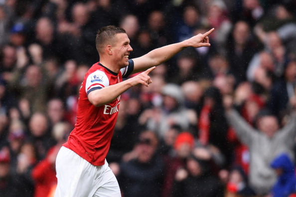 LONDON, ENGLAND - APRIL 13:  Lukas Podolski of Arsenal celebrates scoring Arsenal's third goal of the match during the Barclays Premier League match between Arsenal and Norwich City at Emirates Stadium on April 13, 2013 in London, England.  (Photo by Mike Hewitt/Getty Images)