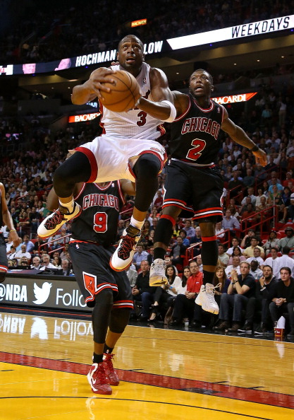 MIAMI, FL - JANUARY 04:  Dwyane Wade #3 of the Miami Heat drives past Nate Robinson #2 of the Chicago Bulls during a game  at AmericanAirlines Arena on January 4, 2013 in Miami, Florida.  (Photo by Mike Ehrmann/Getty Images)