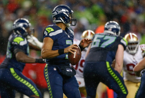 SEATTLE, WA - DECEMBER 23:  Quarterback Russell Wilson #3 of the Seattle Seahawks looks downfield to pass against the San Francisco 49ers at CenturyLink Field on December 23, 2012 in Seattle, Washington.  (Photo by Otto Greule Jr/Getty Images)