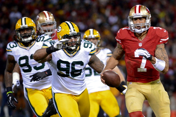 SAN FRANCISCO, CA - JANUARY 12:  Quarterback Colin Kaepernick #7 of the San Francisco 49ers in actions against the Green Bay Packers during the NFC Divisional Playoff Game at Candlestick Park on January 12, 2013 in San Francisco, California.  (Photo by Harry How/Getty Images)