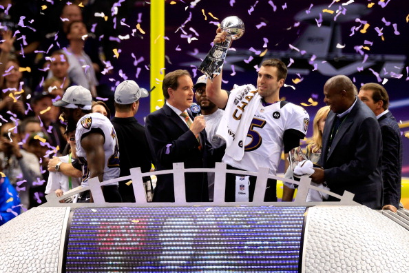 NEW ORLEANS, LA - FEBRUARY 03:  Joe Flacco #5 of the Baltimore Ravens holds up the Vince Lombardi Trophy in front of CBS host Jim Nantz following their 34-31 win against the Baltimore Ravens during Super Bowl XLVII at the Mercedes-Benz Superdome on February 3, 2013 in New Orleans, Louisiana.  (Photo by Jamie Squire/Getty Images)