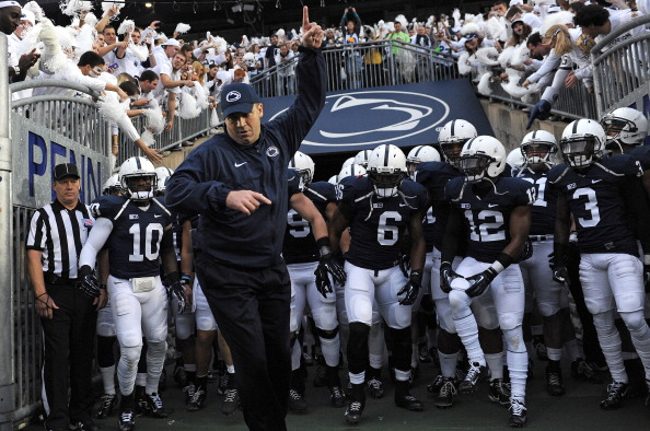 STATE COLLEGE, PA - OCTOBER 27: Head coach Bill O'Brien of the Penn State Nittany Lions leads his team onto the field before playing the Ohio State Buckeyes at Beaver Stadium on October 27, 2012 in State College, Pennsylvania. (Photo by Patrick Smith/Getty Images)