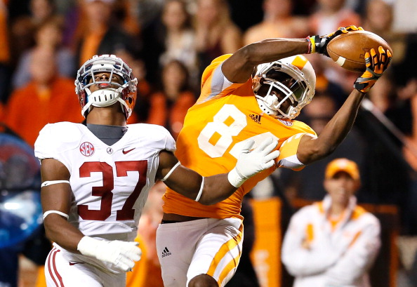 KNOXVILLE, TN - OCTOBER 20:  Cordarrelle Patterson #84 of the Tennessee Volunteers pulls in this reception against Robert Lester #37 of the Alabama Crimson Tide at Neyland Stadium on October 20, 2012 in Knoxville, Tennessee.  (Photo by Kevin C. Cox/Getty Images)