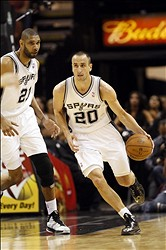 Apr 17, 2013; San Antonio, TX, USA; San Antonio Spurs guard Manu Ginobili (20) handles the ball on a fast break during the first half against the Minnesota Timberwolves at the AT&T Center. Mandatory Credit: Soobum Im-USA TODAY Sports