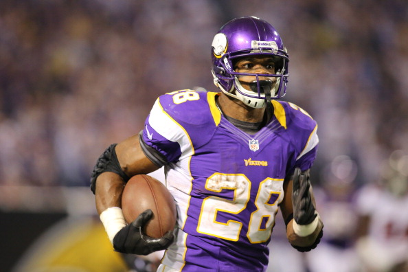 MINNEAPOLIS, MN - OCTOBER 25:  Adrian Peterson #28 of the Minnesota Vikings runs the ball into the end zone for a touchdown against the Tampa Bay Buccaneers at the Hubert H. Humphrey Metrodome on October 25, 2012 in Minneapolis, Minnesota. (Photo by Adam Bettcher/Getty Images)