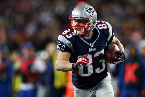 FOXBORO, MA - JANUARY 13:  Wes Welker #83 of the New England Patriots runs with the ball against the Houston Texans during the 2013 AFC Divisional Playoffs game at Gillette Stadium on January 13, 2013 in Foxboro, Massachusetts.  (Photo by Elsa/Getty Images)