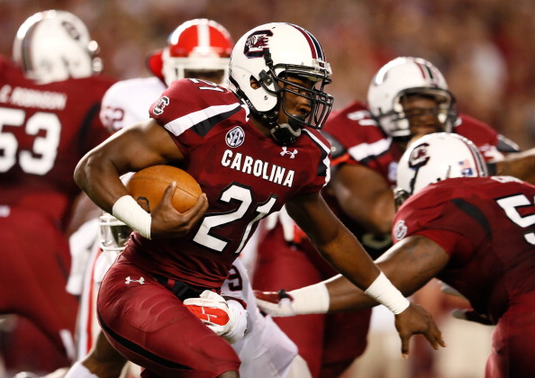 COLUMBIA, SC - OCTOBER 06:  Marcus Lattimore #21 of the South Carolina Gamecocks rushes upfield against the Georgia Bulldogs at Williams-Brice Stadium on October 6, 2012 in Columbia, South Carolina.  (Photo by Kevin C. Cox/Getty Images)