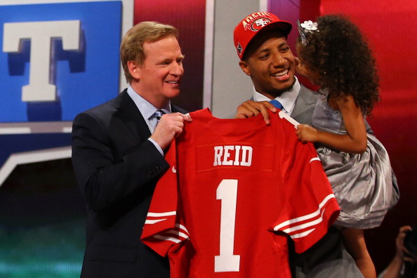 NEW YORK, NY - APRIL 25:  Eric Reid (C) of the LSU Tigers holds his daughter Leilani as they stand with NFL Commissioner Roger Goodell as they hold up a jersey on stage after Reid was picked #18 overall by the San Francisco 49ers in the first round of the 2013 NFL Draft at Radio City Music Hall on April 25, 2013 in New York City.  (Photo by Al Bello/Getty Images)