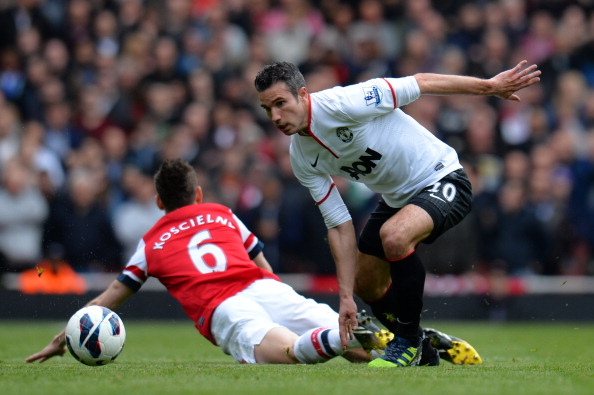LONDON, ENGLAND - APRIL 28:  Robin van Persie of Manchester United clashes with Laurent Koscielny of Arsenal during the Barclays Premier League match between Arsenal and Manchester United at Emirates Stadium on April 28, 2013 in London, England. (Photo by Shaun Botterill/Getty Images)