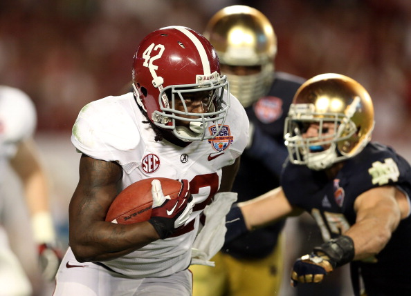 MIAMI GARDENS, FL - JANUARY 07:  Eddie Lacy #42 of the Alabama Crimson Tide runs with the ball against the Notre Dame Fighting Irish during the 2013 Discover BCS National Championship game at Sun Life Stadium on January 7, 2013 in Miami Gardens, Florida.  (Photo by Streeter Lecka/Getty Images)