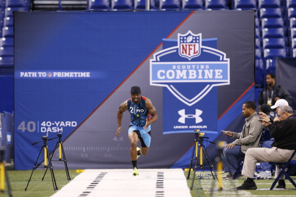 INDIANAPOLIS, IN - FEBRUARY 24: Tavon Austin of West Virginia runs the 40-yard dash during the 2013 NFL Combine at Lucas Oil Stadium on February 24, 2013 in Indianapolis, Indiana. (Photo by Joe Robbins/Getty Images)