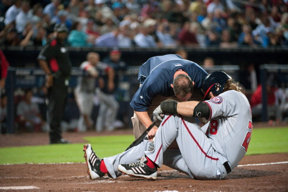 ATLANTA, GA - APRIL 29:  A trainer checks on Jayson Werth #28 of the Washington Nationals after he fouled a ball off his foot in the 8th inning against the Atlanta Braves at Turner Field on April 29, 2013 in Atlanta, Georgia. The Braves defeated the Nationals 3-2. (Photo by Kevin Liles/Getty Images)