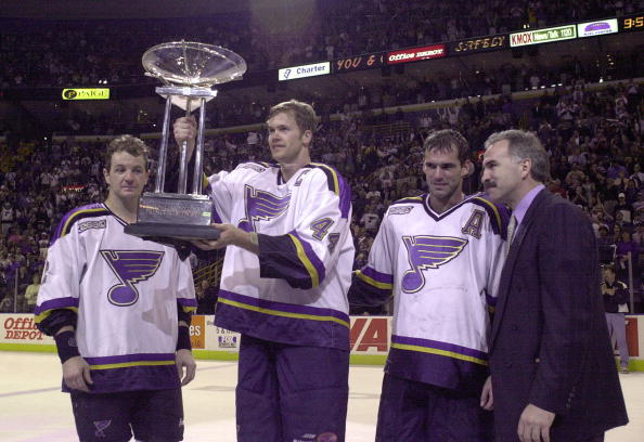 5 Apr 2000: Chris Pronger #44 of the St. Louis Blues salutes the crowd with the President''s Trophy for the best regular season record in the league. At Pronger''s side are Al MacInnis #2 , Pierre Turgeon #77 and head coach Joel Quenneville of the Blues at the Kiel Center in St. Louis, Missouri. The Blues beat the Calgary Flames 6-5. DIGITAL IMAGE