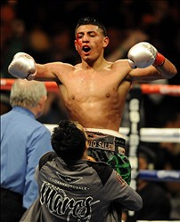 December 3, 2011; Anaheim, CA, USA; Abner Mares celebrates after winning a judges decision against Joseph Agbeko to keep his IBF bantamweight title at the Honda Center. Mandatory Credit: Christopher Hanewinckel-USA TODAY Sports