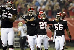 Nov 29, 2012; Atlanta, GA, USA;  Atlanta Falcons free safety Thomas DeCoud (28) reacts after his interception in the endzone against the New Orleans Saints surrounded by his teammates middle linebacker Akeem Dent (52) , defensive tackle Corey Peters (91) , outside linebacker Sean Weatherspoon (56) during the first quarter of their game at the Georgia Dome. Mandatory Credit: John David Mercer-USA TODAY Sports