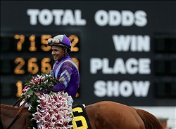May 3, 2013; Louisville, KY, USA; Garrett Gomez aboard Beholder (3) celebrates after winning the 2013 Kentucky Oaks at Churchill Downs. Mandatory Credit: Brian Spurlock-USA TODAY Sports