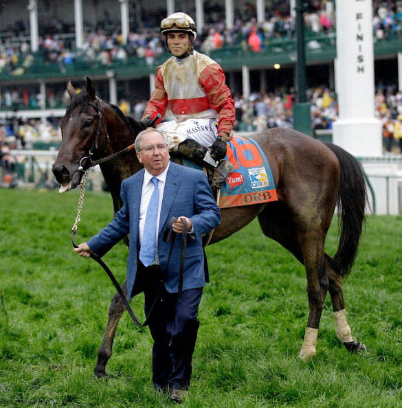 LOUISVILLE, KY - MAY 04:  Trainer Shug McGaughey (L) walks with Orb ridden by jockey Joel Rosario after winning the 139th running of the Kentucky Derby at Churchill Downs on May 4, 2013 in Louisville, Kentucky.  (Photo by Rob Carr/Getty Images)