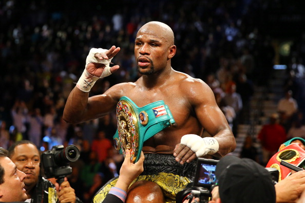 LAS VEGAS, NV - MAY 04:  Floyd Mayweather Jr. celebrates his unanimous decision victory against Robert Guerrero in their WBC welterweight title bout at the MGM Grand Garden Arena on May 4, 2013 in Las Vegas, Nevada.  (Photo by Al Bello/Getty Images)