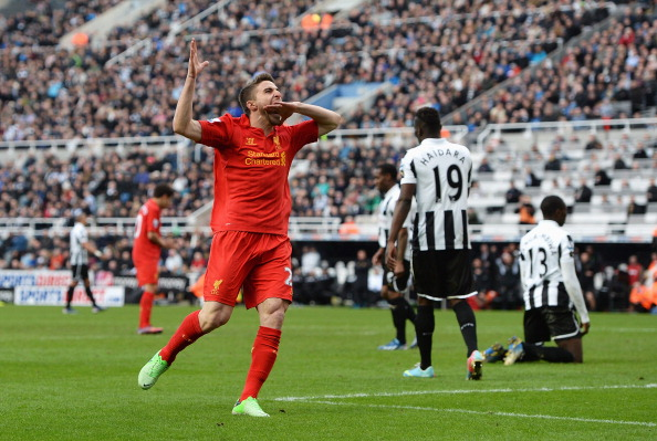 NEWCASTLE UPON TYNE, ENGLAND - APRIL 27: Fabio Borini of Liverpool celebrates scoring the fifth Liverpool goal during the Barclays Premier League match between Newcastle United and Liverpool at St James' Park on April 27, 2013 in Newcastle upon Tyne, England.  (Photo by Gareth Copley/Getty Images)