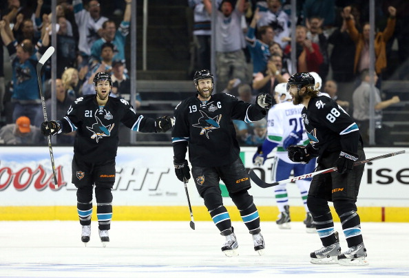 SAN JOSE, CA - MAY 07:  (L-R) T.J. Galiardi #21, Joe Thornton #19 and Brent Burns #88 of the San Jose Sharks celebrate after Burns scored a first period goal against the Vancouver Canucks in Game Four of the Western Conference Quarterfinals during the 2013 NHL Stanley Cup Playoffs at HP Pavilion on May 7, 2013 in San Jose, California.  (Photo by Christian Petersen/Getty Images)