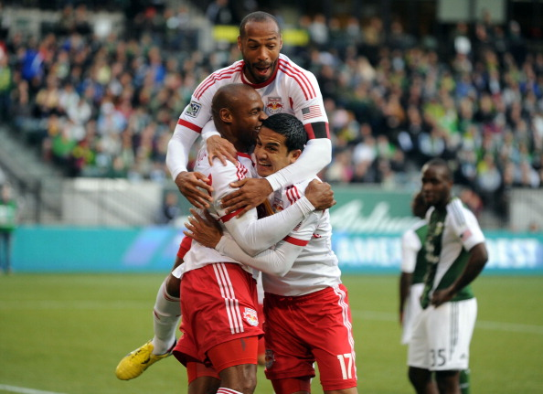 PORTLAND, OR - MARCH 03: Jamison Olave #4, Thierry Henry #14 and Tim Cahill #17 of New York Red Bulls celebrate a goal during the first half of the game against the Portland Timbers at Jeld-Wen Field on March 03, 2013 in Portland, Oregon. (Photo by Steve Dykes/Getty Images)