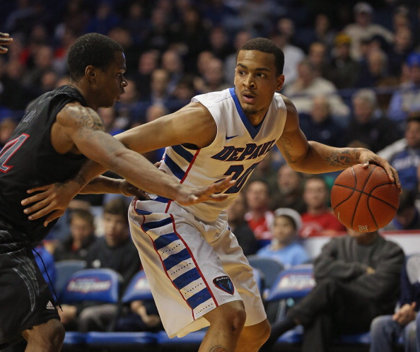 ROSEMONT, IL - JANUARY 15:  Brandon Young #20  of the DePaul Blue Demons moves against Ge'Lawn Guyn #14 of the Cincinnati Bearcats at Allstate Arena on January 15, 2013 in Rosemont, Illinois.  Cincinnati defeated DePaul 75-70.  (Photo by Jonathan Daniel/Getty Images)