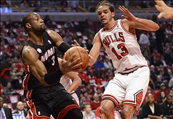 May 13, 2013; Chicago, IL, USA; Miami Heat shooting guard Dwyane Wade (3) attempts to shoot over Chicago Bulls center Joakim Noah (13) during the first quarter at the United Center. Mandatory Credit: Mike DiNovo-USA TODAY Sports