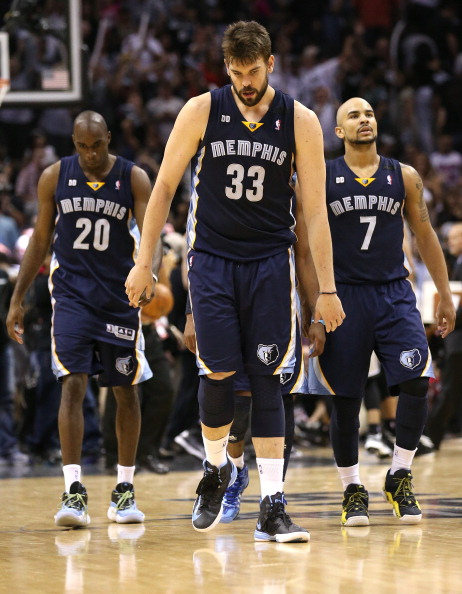 SAN ANTONIO, TX - MAY 21:  (L-R) Quincy Pondexter #20, Marc Gasol #33 and Jerryd Bayless #7 of the Memphis Grizzlies react dejected after they lost in overtime 93-89 against the San Antonio Spurs during Game Two of the Western Conference Finals of the 2013 NBA Playoffs at AT&T Center on May 21, 2013 in San Antonio, Texas.  (Photo by Stephen Dunn/Getty Images)